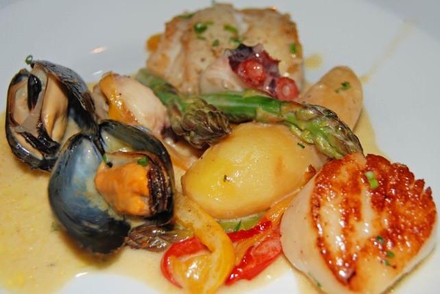 La Cocotte - Fish and Shellfish Stew Served with Potatoes and Asparagus