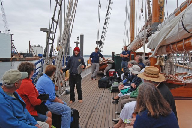 First Mate Kris Jones Welcomes Passengers Aboard Schooner Zodiac