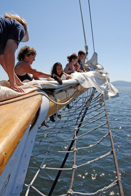 Passengers and Crew Furl the Jib