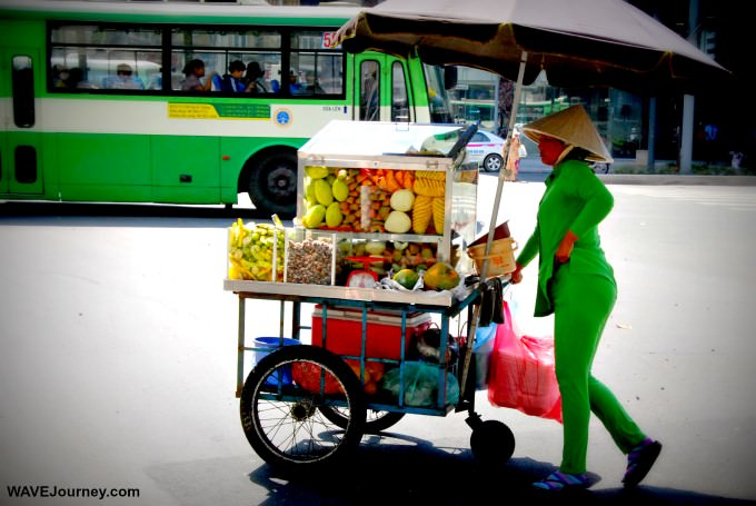 Woman with Fruit For Sale in Saigon