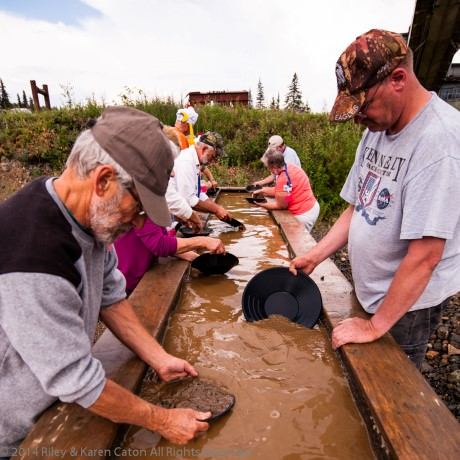 Visitors gold panning behind the gift shop/café