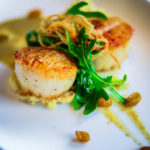 Start with Seared Scallops and a Golden Raisin Caper Sauce