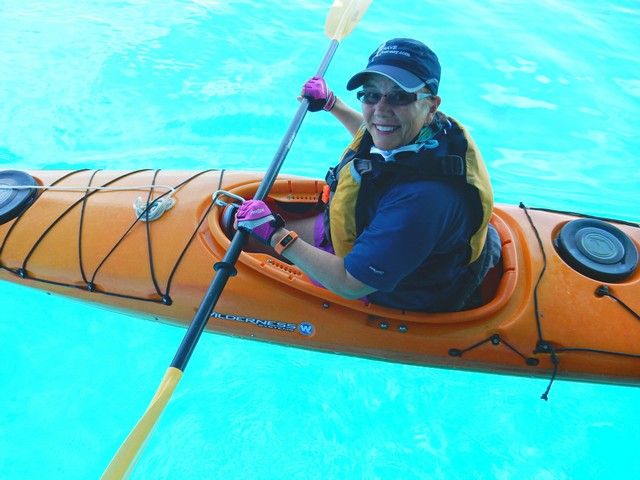 Jill Takes a Kayak for a Spin off the Aft Deck of Grande Mariner