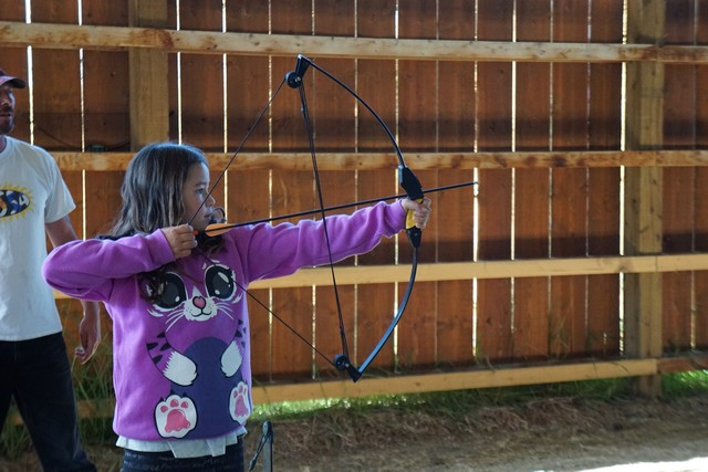 Jada Practices Archery at Echo Valley Ranch