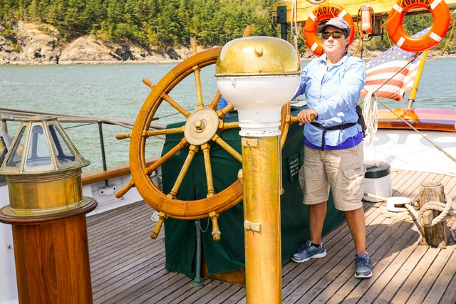 Viv takes the helm of Schooner Zodiac.