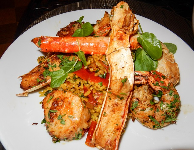 Valencia Paella entrée with Alaskan King Crab Legs, Shrimp, Scallops and Chorizo
