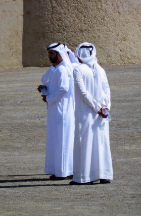 Men in Abu Dhabi wearing dish-dasha robes