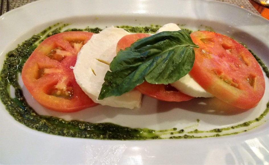 Giovanni's Table - Mozzarella di Buffalo with heirloom tomatoes and pesto